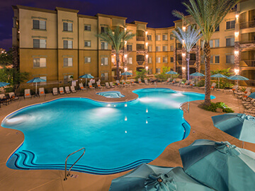 Toscana Condo Rentals pool in the evening